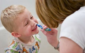 Boy Brushing Teeth 300x188